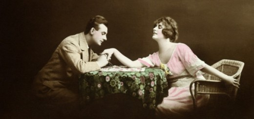 Man holding woman's hand at table